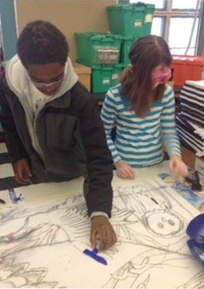 Students working with an illustration for the mural