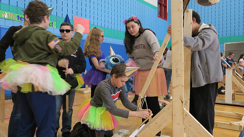 Kennedy students prepare their catapult