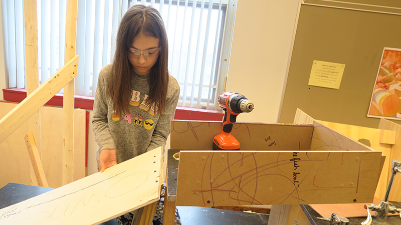 Student assembles last year's engineering project