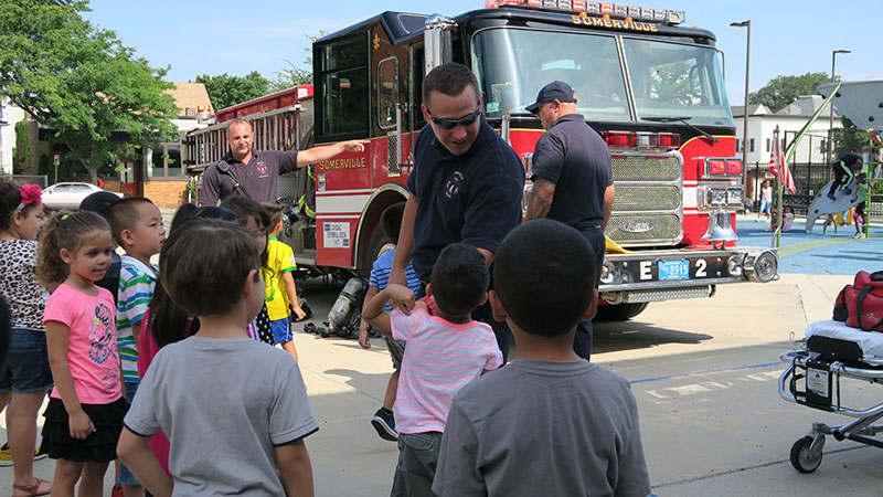 SPELL students talking to Somerville firefighters