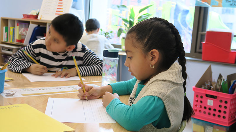 UNIDOS first graders at ESCS working at their desks