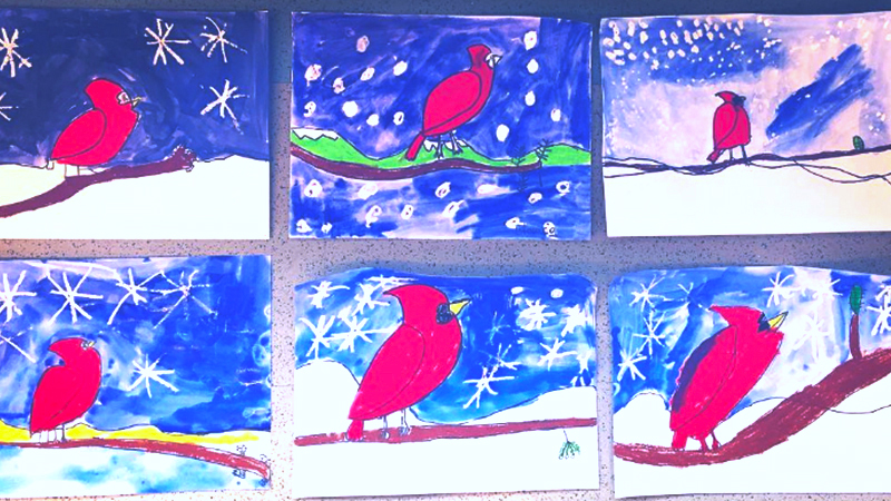 Student Kindergarten Artwork of Cardinals on a snowy backdrop