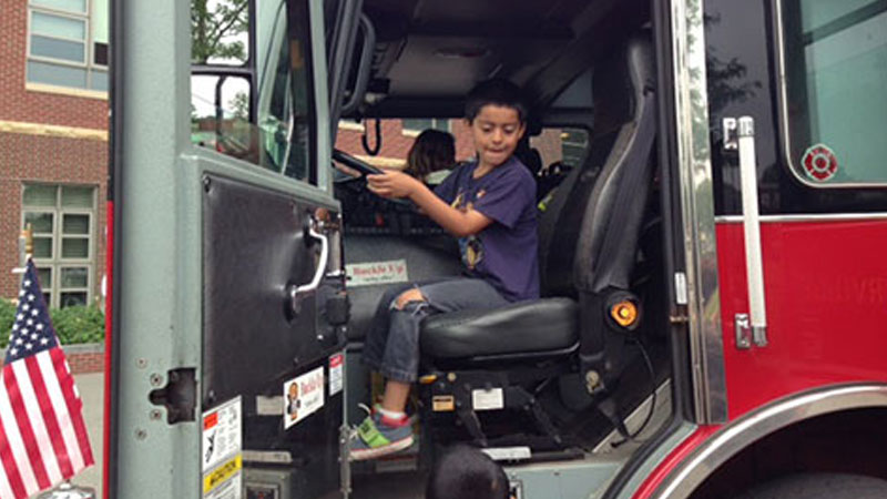SPELL Student sits in a Firetruck