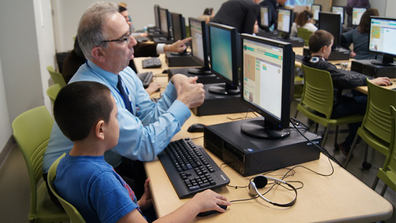 Staff member and student in computer lab