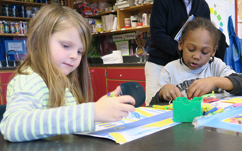 Two Kennedy students in art class