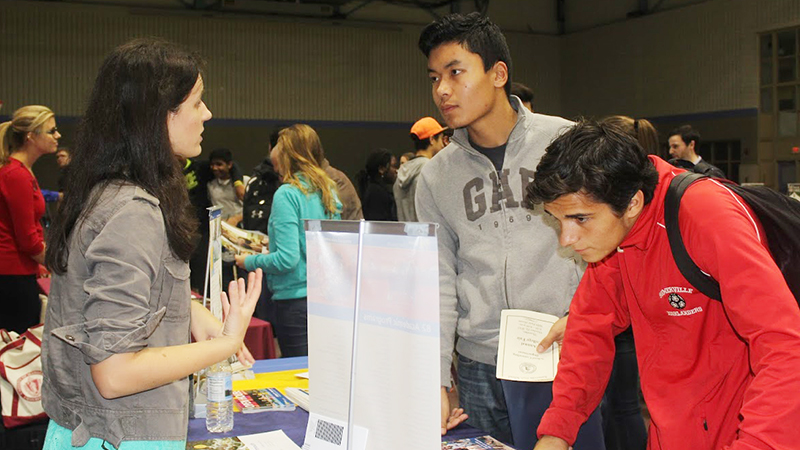 Students speak with a college rep