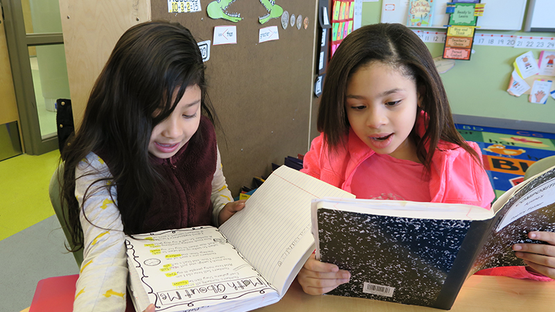 East Somerville students reading together