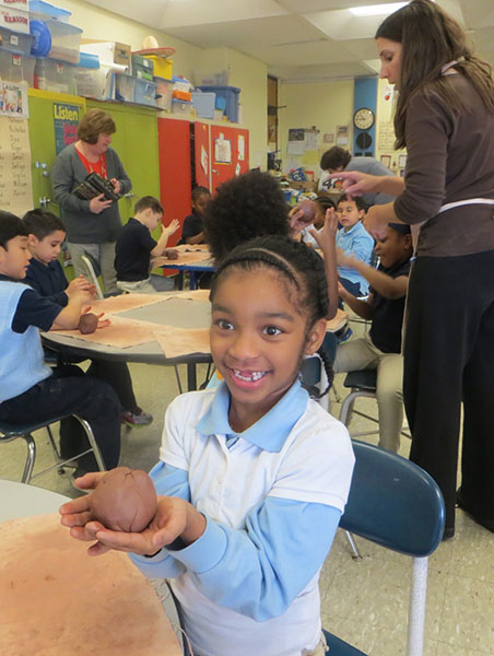 Students work with clay in the classroom at Winter Hill